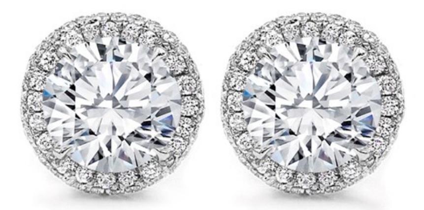 Two Diamond Stud Earrings