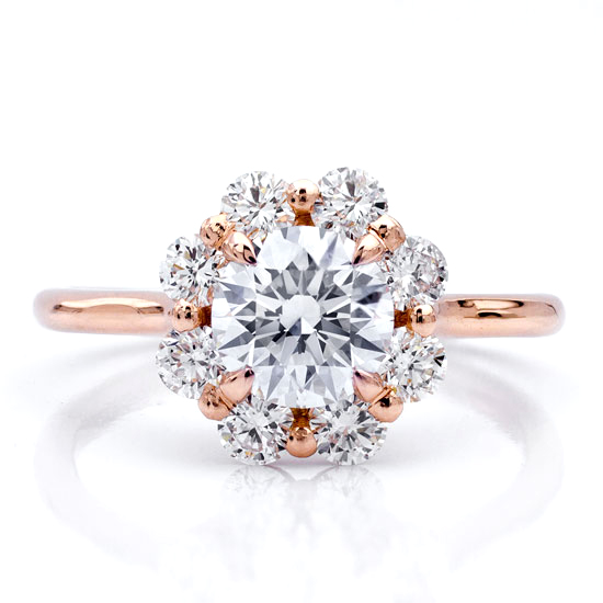 A custom rose gold engagement setting with a flower halo of round diamonds