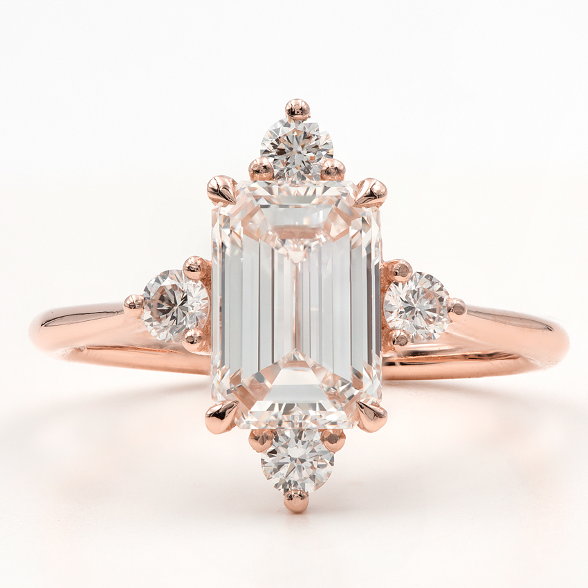 A custom design engagement setting with round diamonds on the prongs