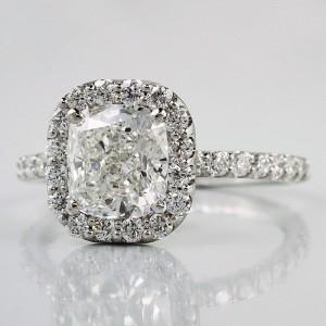 A cushion cut diamond halo engagement ring customized .from Adiamor