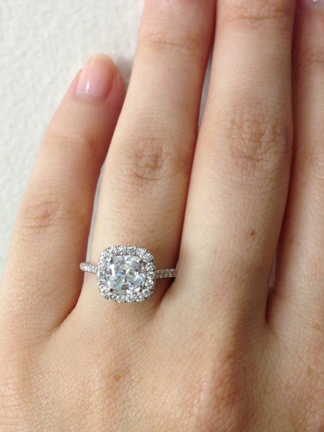 Diamond Halo Engagement Ring With A Cushion Cut