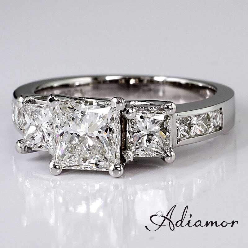 Three stone with princess cut diamonds.
