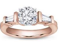 rose gold three stone ring